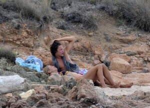 Heidi Klum Caught topless at a beach