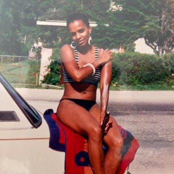 VANESSA BELL CALLOWAY *early years, bikini, putting on sunscreen*