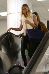 Gwyneth Paltrow Lands at LAX after a rainy visit to New York October 28-2015 x26