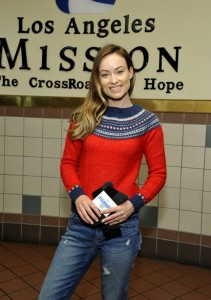 Olivia Wilde helps Gap and Bombas hand out socks at Los Angeles Mission in Los Angeles, California on December 9, 2015